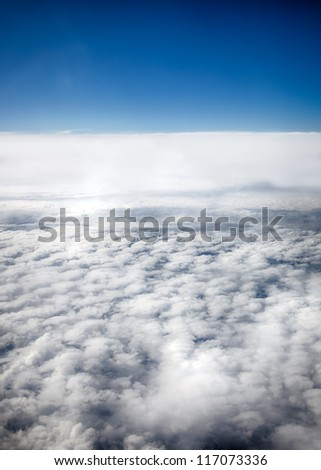 View of clouds from a airplane window. HDR image