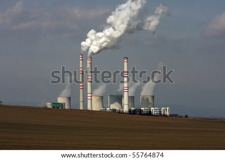 view of coal power plant over the field