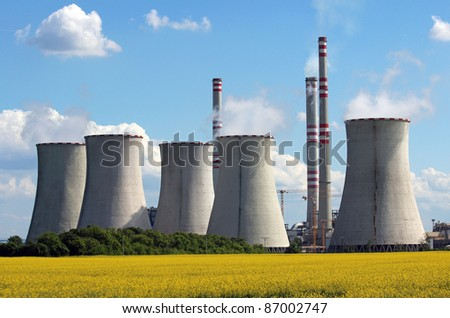 view of coal power plant over yellow agriculture field