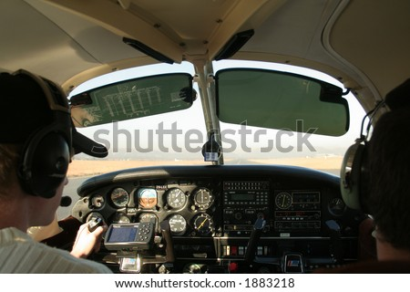View of cockpit of plane while flying