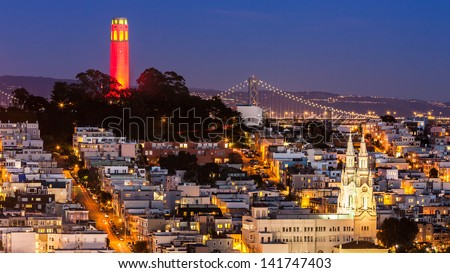 View of Coit Tower and St. Peter and Paul church at night, from Lombard street.