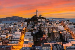 View of Coit tower with sunset sky in downtown San Francisco, California.