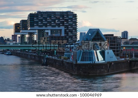 view of Cologne with the chocolate museum at the rhine banks and the modern crane houses behind