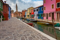 View of colorful houses along the canal on the island Burano. Burano. Italy. Venice.