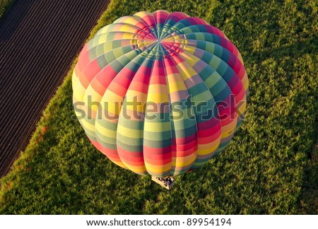 View of colourful hot air balloon from above, over Egypt at dawn