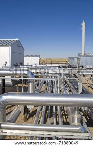View of compressor site pipes carrying natural gas