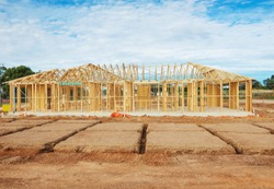 view of construction site with  framing house and foundation in preparation process