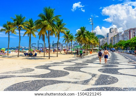 View of Copacabana beach and Leme beach with palms and mosaic of sidewalk in Rio de Janeiro, Brazil. Copacabana beach is the most famous beach of Rio de Janeiro, Brazil. cityscape of Rio de Janeiro