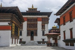 View of courtyard and utse in Tashichho dzong in Thimphu capital city of Bhutan, fortress monastery and seat of the government