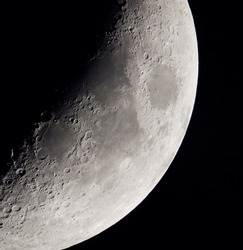 View of crescent Moon with telescope.