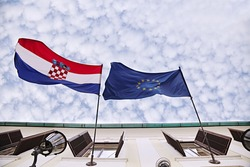 View of Croatia and european flags.