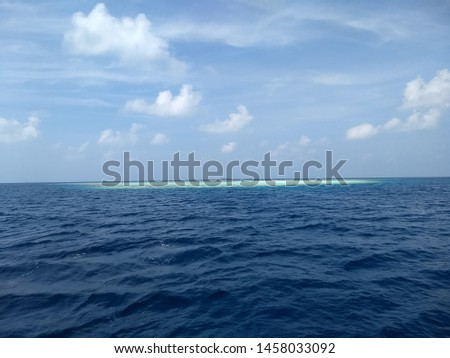 View of crystal clear water with clear blue sky #1458033092