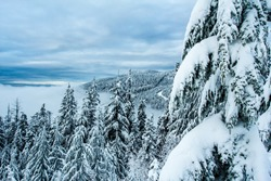 View of Cypress Mountain with cloud covered valley as seen from Mount Hollyburn, near Vancouver, British Columbia, Canada