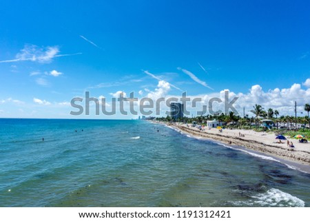 View of Dania beach in Hollywood, Florida. People enjoying their vacation and swimming in the beach in summer Zdjęcia stock ©