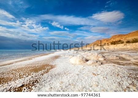 View of Dead Sea coastline and salt crystals