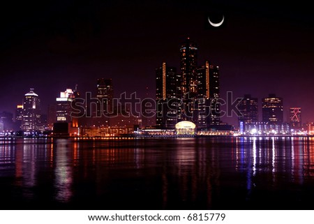 view of Detroit skyline at night and moon, Michigan