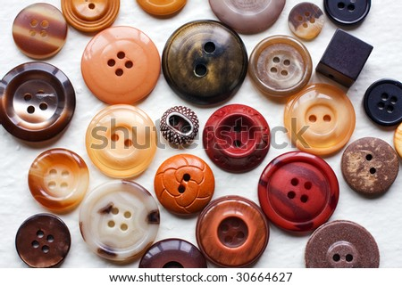 View of different sized shades of brown buttons.