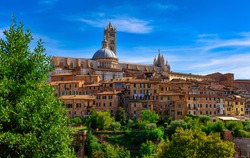 View of Dome and campanile of Siena Cathedral (Duomo di Siena) in Siena, Italy. Siena is capital of province of Siena. Historic centre of Siena has been declared by UNESCO a World Heritage Site