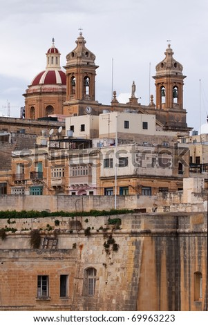 View of dome and clock towers of  St. Lawrennce Cathedral at Vittoriosa. Malta
