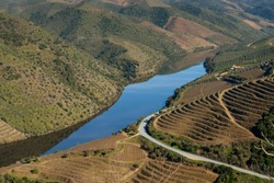 View of Douro River with terraced vineyards near the village of Foz Coa, in Portugal; Concept for travel in Portugal and most beautiful places in Portugal
