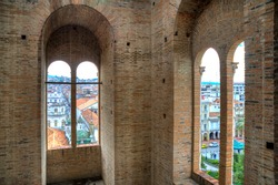 View of downtown Cuenca, Ecuador, from inside one of the towers of the Cuenca Cathedral, on a sunny morning.