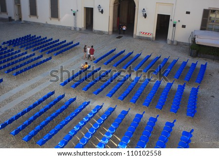 View of Empty blue chairs for outdoor cinema