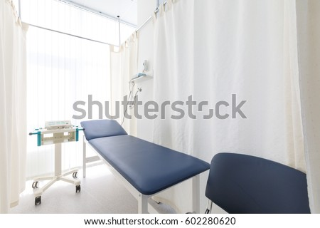 View Of Empty Doctor's Surgery. Doctor's office, blue and white interior
