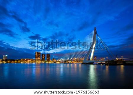 View of Erasmus Bridge (Erasmusbrug) and Rotterdam skyline cityscape illuminated at night. Rotterdam, Netherlands Stockfoto ©