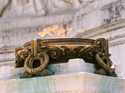 View of Eternal flame for the Italian Unknown Soldier memorial at the Victor Emmanuel II Monument in Rome,  Italy.
