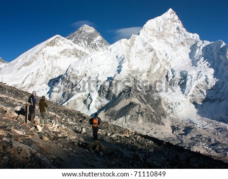 view of Everest and Nuptse from Kala Patthar with people