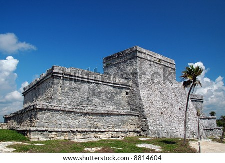 View of facade of an Ancient Mayan Fortress at the Seashore in Tulum