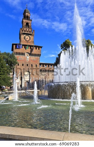 View of famous fountain and Castle tower on the Castle square. Milan, Italy