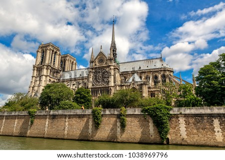 View of famous Notre-Dame de Paris Cathedral under beautiful sky in Paris, France.