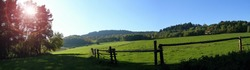 View of fences for horses, countryside, beautiful summer weather.