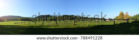 Stock Photo View of fences for horses, countryside, beautiful summer weather.