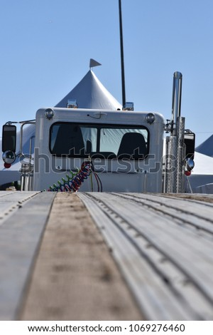 View of flat bed trailer looking towards the cab #1069276460