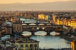 View of Florence Vecchio Bridge and Arno river from Piazzale de Michelangelo during sunset
