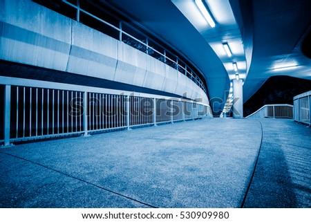 view of footbridge at night in Hong Kong,China. #530909980