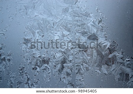 View of  frost on  glass window. Image with shallow depth of field. - stock photo