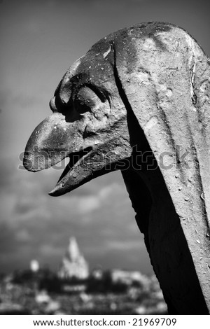 View of gargoyle on top of Notre Dame Cathedral in Paris