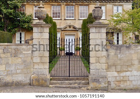 View of Gateway and Exterior Stone Wall of a Beautiful Old English Mansion House
