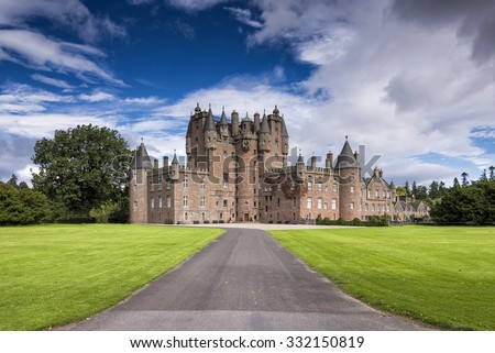 View of Glamis Castle in Scotland, United Kingdom. Glamis Castle is situated beside the village of Glamis in Angus. It is the home of the Countess of Strathmore and Kinghorne, and is open to public. #332150819