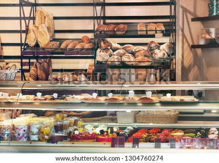 View of glass display full of various appetizing confectioneries in pastry shop in France