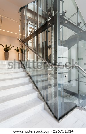 View of glass elevator in modern building