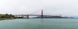 View of Golden Gate Bridge in SanFrancisco, a day of clouds and thick fog