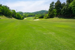 View of Golf Course with beautiful fairway field. Golf course with a rich green turf beautiful scenery.
