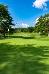View of Golf Course with beautiful green field. Golf course with a rich green turf beautiful scenery.