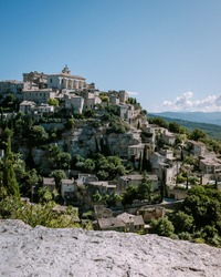 View of Gordes, a small medieval town in Provence, France. A view of the ledges of the roof of this beautiful village and landscape. Europe