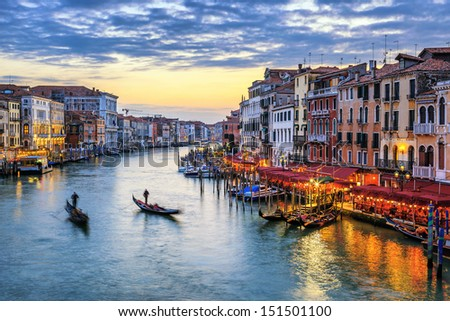 View of Grand Canal with gondolas at sunset in Venice #151501100