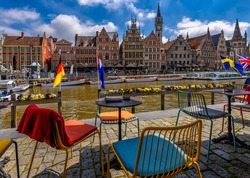 View of Graslei, Korenlei quays and Leie river in the historic city center in Ghent (Gent), Belgium. Architecture and landmark of Ghent. Cityscape of Ghent.